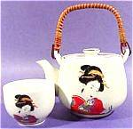 This vintage Oriental Geisha tea set has a different Geisha on each cup. The teapot also has a Geisha with Japanese figures. The set is in excellent condition with some light crazing. The teapot measu...