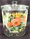 This is a very colorful vintage storage jar for cookies, crackers, biscuits or any number of things one might want to use it for. It has some oldtime floral decals that are a little frayed but still b...
