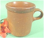 This is a McCoy pottery coffee mug from the Canyon line and was made in 1977. It is marked 1412 McCoy USA. It has one very tiny fleabite on the rim. If you are looking for a spare or replacement, you ...