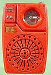 This is a solid state AM transistor radio. It is in good working condition and runs on a 9 volt battery (not included). The case is red plastic and in good condition, although the hand strap is missin...