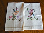 Two vintage linen embroidered tea towels. LINEN towels that are the same size with embroidered pictures on them. One features flowers and leaves; the other features a butterfly and leaves. The leaves/...