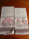 Very cute vintage embroidered dog kitchen towels. These are LINEN towels that do not appear to have been used and feature puppies. No holes, tears or spots that I noticed.
