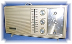 1960s Zenith Transistor Radio, that plays great. I had the radio in my kitchen for years, and the tone is as good as my Bose. It is Model 7466L and the case is a pale creamy grey plastic. It is 12 1/2...