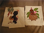 Such a great find for anyone who collects Black americana.  Hand painted tea towels with scenes of a young native girl.  One she is taking a bath in a pot the other is collecting coconuts, which are f...