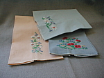 "Three great hand embroidered tea towels.  Each towel is 12"" X 18"" and has different flower scenes hand embroidered on the bottom.  All are in excellent shape, no rips or tears."