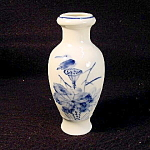 Small Oriental Blue And White Vase.
