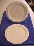 Pair Of White Stoneware Plates