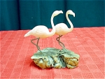 A Pair Of Flamingos On A Wood Base