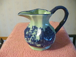 Flow Blue Pitcher With Small Town Square Scenery