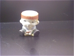 Occupied Japan Egg Cup Titled Sitting Boy