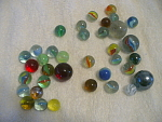 Collection Of 36 Glass Marbles Of Different Sizes