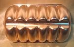 Small Eclair Shaped Copper Colored Jello Mold