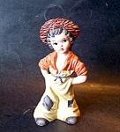 Girl In Rust Color Hat, Porcelain