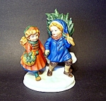 Bringing Home The Tree, Avon Figurine
