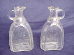 A Pair Of Syrup Bottles Circa 1920's