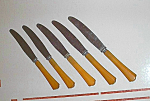 Five French Ivory Or Celluloid Butterknives