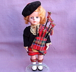 Scottish Lassie W/ Bagpipes Plastic Storybook Doll