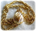 Avon Gold Egg Shaped Solid Perfume Locket And Chain