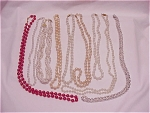 Vintage Costume Jewelry - 9 Necklaces - 3 Signed Monet, Pearls, Red Glass Bead, Silver Tone