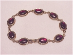 Vintage Costume Jewelry - Dark Red Glass Or Lucite Cabachon Gold Tone Bracelet