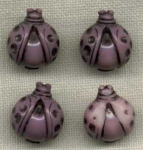 4 Purple Lady Bug Plastic Goofy Buttons.