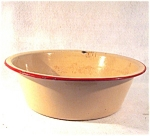 Yellow And Red Enamelware Pan