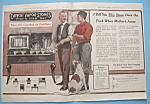 1917 Detroit Vapor Stoves With Two Men By Stove
