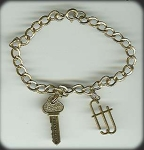 Charm Bracelet With 'key To Success' And Fjj Sterling Charms