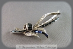 Foliate Silver And Rhinestone Brooch With Blue Baguettes