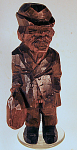 Signed Rb Flat Plane Style Carving Man W/bag & Hat