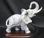 Elephant On Wood Base