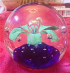 Handblown Glass Paperweight With Floral Design And Controlled Bubbles