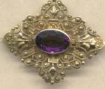Victorian Pin Of Filigree With Purple Stone