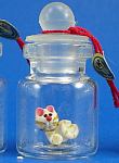 Miniature Cat In A Bottle