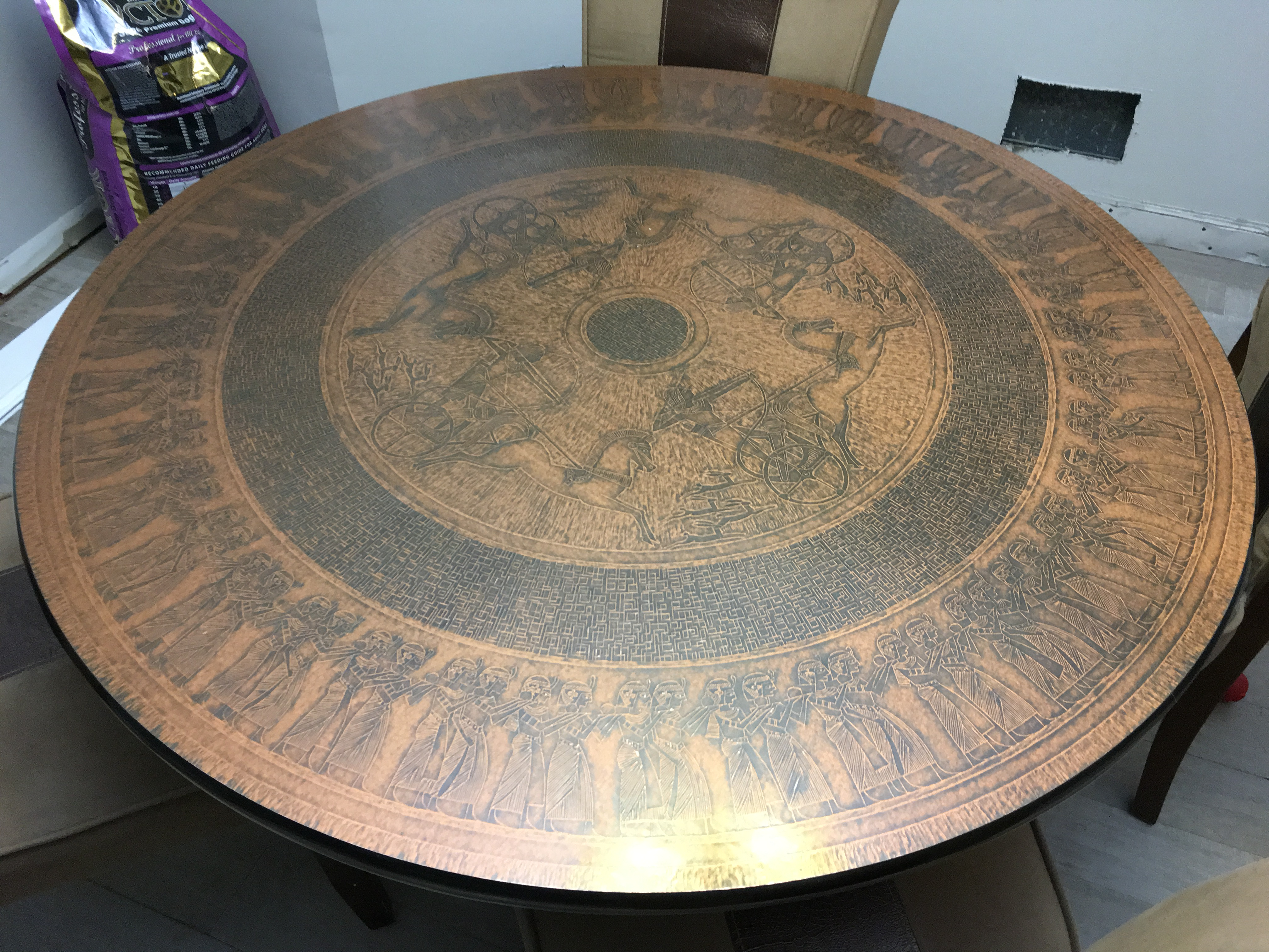 Hand hammered copper top table