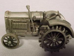 Click here to enlarge image and see more about item 2JD11: Pewter McCormick-Deering tractor by Spec Cast