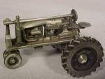 Click here to enlarge image and see more about item 2JD3: Pewter Farmall F-20 by Spec Cast