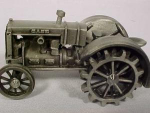 Click here to enlarge image and see more about item 2JD4: Pewter Case On steel Wheels Tractor by Spec Cast