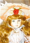 Click here to enlarge image and see more about item 1350: Porcelain Musical Doll by Bette Ball