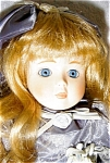 Click here to enlarge image and see more about item 1444: Seymour Mann Porcelain Doll, Paulette