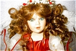 Click here to enlarge image and see more about item 1515: Seymour Mann Porcelain Doll, Mistletoe