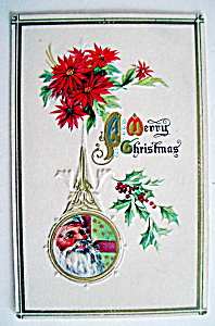 A Merry Christmas Postcard w/Flowers & Santa Claus Face (Image1)