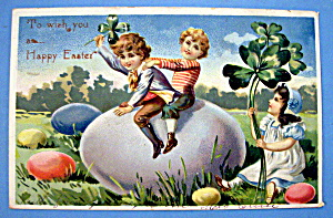 Happy Easter Postcard By Tuck's with Children on an Egg (Image1)