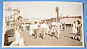 Photograph Of Carnival Scene With People Walking