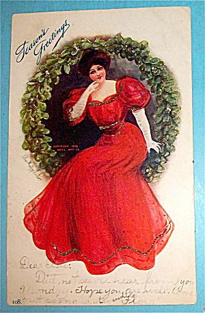 Seasons Greetings With Lady Sitting in Wreath Postcard (Image1)