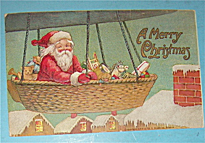 1907 A Merry Christmas Postcard with Santa In Balloon (Image1)