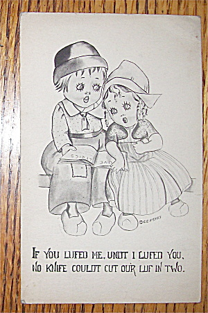 Dutch Boy And Girl Sitting Next To Each Other Postcard