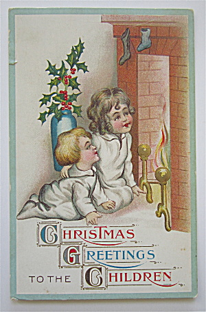 Girl And Boy Waiting For Santa To Come Down Chimney (Image1)