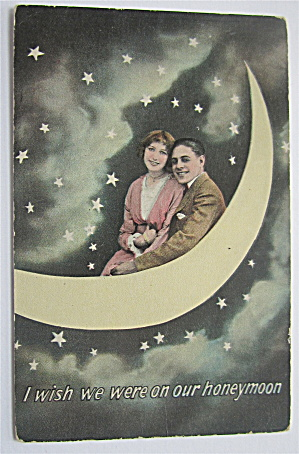 Man And Woman Sitting On A Moon Postcard