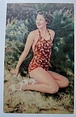 Woman Sitting On Sand Smiling Postcard